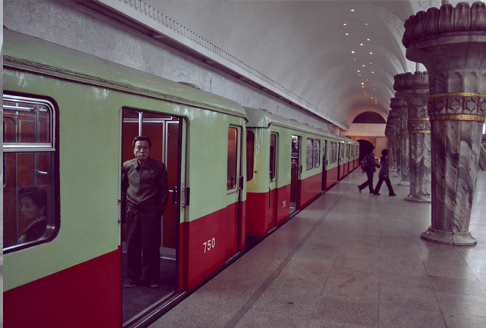 North Korea Travel: Man watches on Pyongyang Metro as door closes