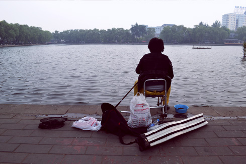 beijing-china-fisherman-at-xiahai-lake